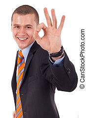 ok! - Young business man, in the suit, showing a sign ok