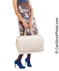 woman holding big purse - cut out image of a Young woman...