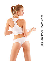 back picture of a sexy blond woman pulling her undershirt