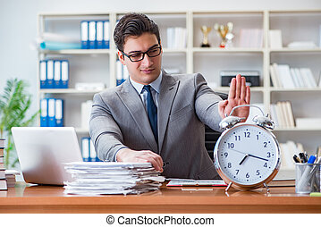 The young businessman in time management concept