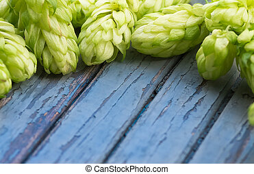 Green hops, malt, on a wooden old table - Green hops, malt,...
