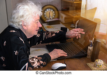 Grandmother learns to work at home on the computer