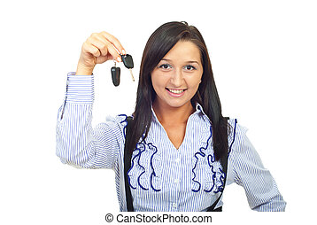 Young woman holding car keys isolated on white background