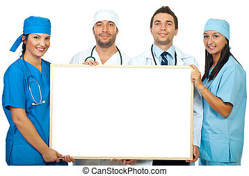 Four doctors holding blank banner - Four smiling different...