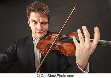 Man playing violin showing emotions and expressions - Music...