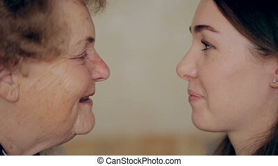 concept of aging and skin care. face of young woman and an old woman with wrinkles.