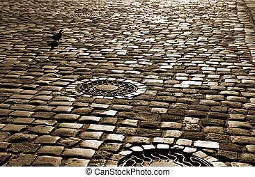 road with paved stone blocks - ancient road with paved stone...