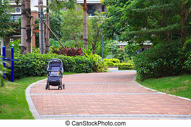 Stroller in garden - An empty stroller standing on a...