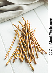 Salty pretzel sticks. - Salty pretzel sticks on white table.