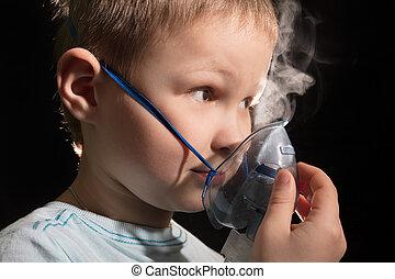 Kid breathing through nebulizer mask