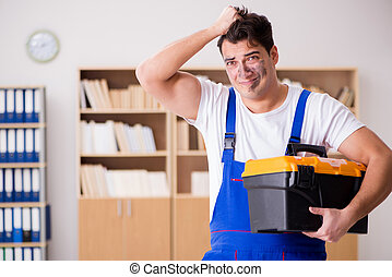 Funny worker with dirty face and toolkit