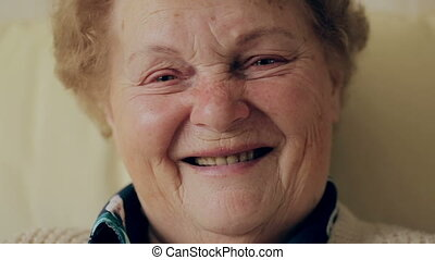 Senior portrait, happy old woman with eyeglasses smiling and looking at camera.