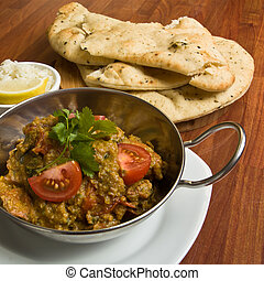 Indian Curry meal of spicy chicken, rice and naan bread