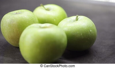 Beautiful washed green apples on the table.