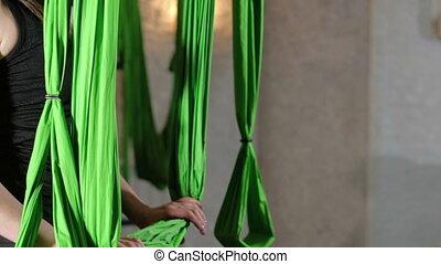 Practice of anti gravity fly yoga with hammock. 4K -...