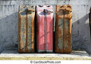 rusty fuel tanks - three rusty fuel tanks in harbour