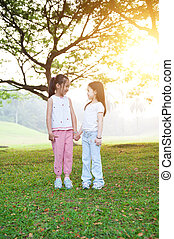 Asian sisters outdoor portrait.