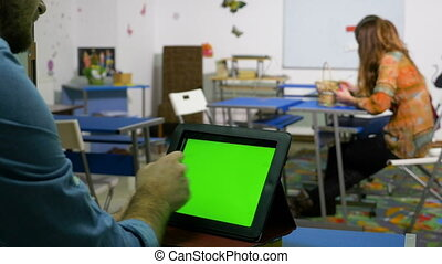 Young entrepreneur man using tablet pc with green screen in...