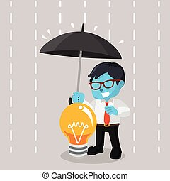 blue businessman covering idea with umbrella