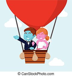 married couple flying with air balloon