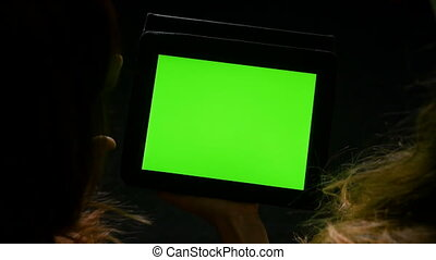 Two women having a debate with green screen tablet pc in...