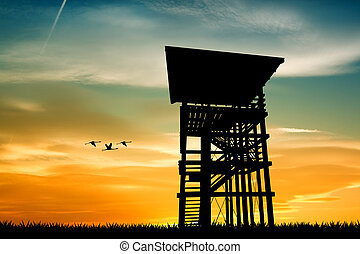 watchtower at sunset - illustration of watchtower at sunset