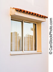 modern window outdoor. A window in a peach-colored building