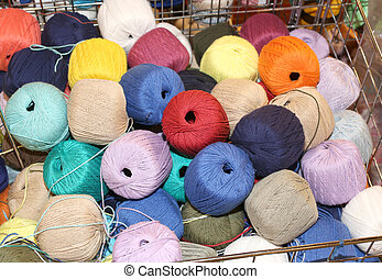 wool balls on sale in the haberdashery - colored wool balls...