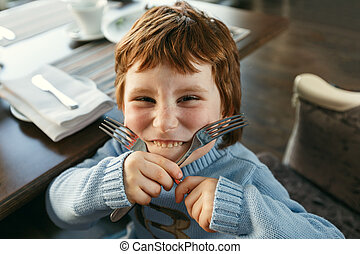 Red haired boy with forks playing the ape - Little red...