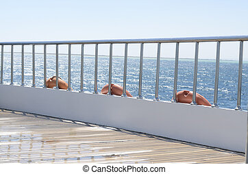 Deck on the stern of the yacht on a sunny day and beautiful...