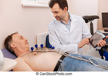 Qualified caring doctor explaining diagnosis to his patient