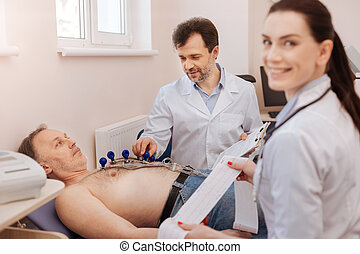 Trained medical professionals monitoring the procedure