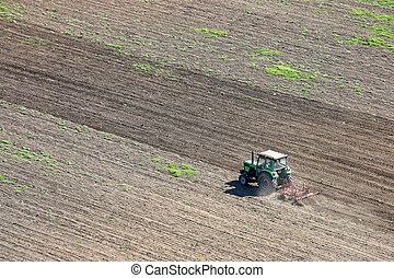 tractor plowing a field agriculture