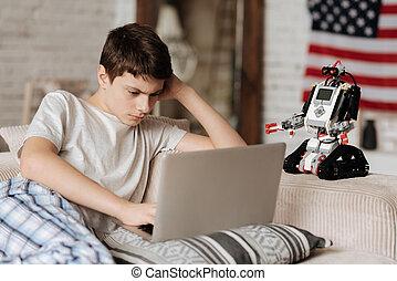 Angry teenager looking at computer