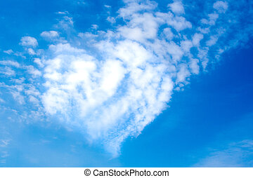 Heart shape clouds on a sunny day