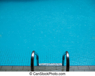 Pool with ladder on edge - Photo of swimming pool with...