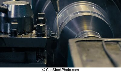 Working lathe with water jet cooling - Close up of working...