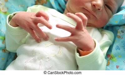 ugly newborn baby with tiny hand in focus. shaking hands.