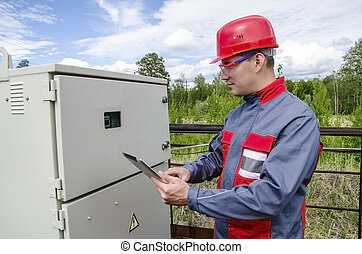 Electrician builder engineer checking data