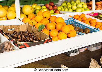 Fruit market with various colorful fresh fruits and vegetables