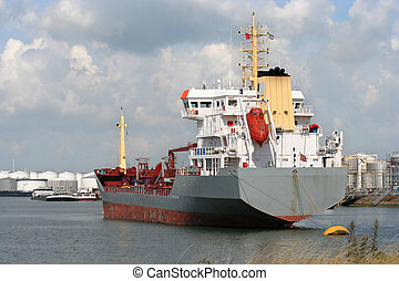 Freight Ship - Freight ship in Rotterdam harbor, oil depots...