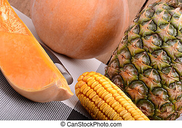 collection of fruit and vegetables. Pineapple, corn, pumpkin, orange