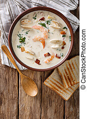 American cuisine: New England clam chowder soup closeup....