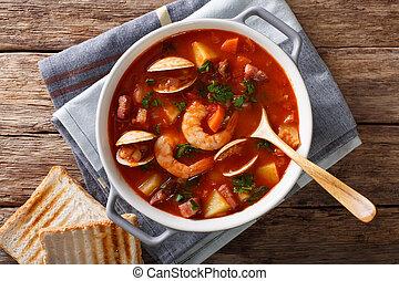 American cuisine: Manhattan clam chowder soup closeup....