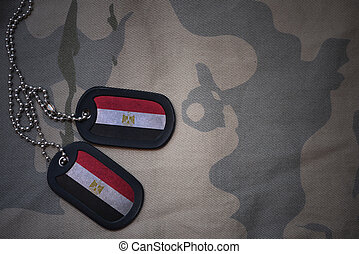 army blank, dog tag with flag of egypt on the khaki texture...