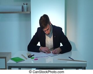Man writing documents