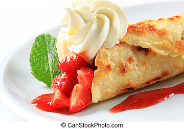 Crepe with fresh strawberries and whipping cream