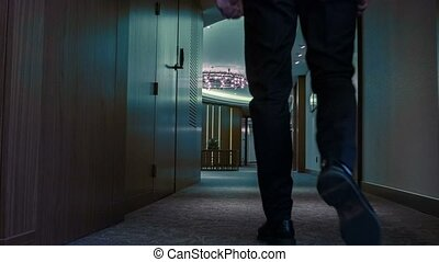 Rear view of businessman walking in business center