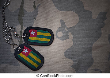 army blank, dog tag with flag of togo on the khaki texture...
