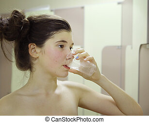 sportsman teen girl drink water from plastic glass after...